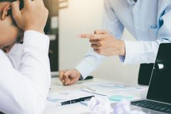 Business teamwork blaming partner and serious discussion stock images