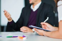 Business teamwork brainstorming concept, group of collegues in office. Young bysinessmen work together. Closeup, selective focus Stock Image