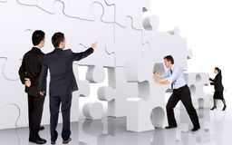 Business teamwork - business men making a puzzle Stock Image