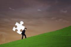 Business teamwork - businessman carry puzzle Stock Photos