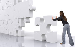Business teamwork - businesswoman building a puzzle Stock Photos
