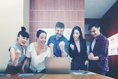 Business teamwork celebrating good project results. royalty free stock photo