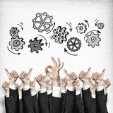 Business and teamwork concept. Group of hands of businesspeople showing gestures on wooden background royalty free stock images