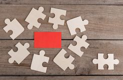 Jigsaw Puzzle Pieces on wooden background stock images
