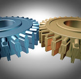 Business Teamwork. Concept with two merged gears or cog wheels shaped as business people icons in a meeting connected together as an organized working Royalty Free Stock Photography