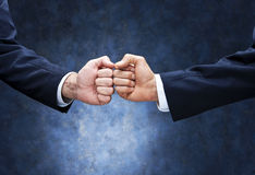 Business Teamwork Fist Bump. Two business men doing a fist bump Stock Image