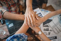 Business teamwork hand together. Success people meeting group working in office. Trust support power strong business partner. Concept. Top view over graphs on royalty free stock photos