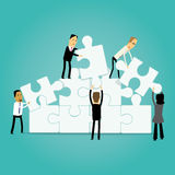 Business teamwork illustration. Group of cartoon business people handling puzzle pieces Stock Images
