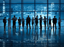 Business Teamwork in the Office at Night Royalty Free Stock Images