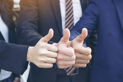 Business teamwork partners giving Thumb up Successful stock photography
