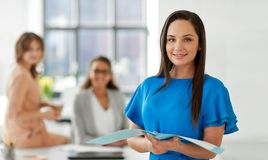 Businesswoman with folder at office. Business, teamwork and people concept - businesswoman with folder at office Stock Photos