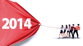 Business teamwork pull number of 2014. New future business concept with business teamwork pulling number of 2014 Royalty Free Stock Photography