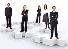 Business teamwork on puzzle Stock Photography