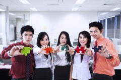 Business teamwork and puzzle pieces at office Royalty Free Stock Photos