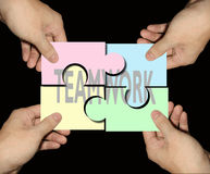 Business teamwork puzzles. Teamwork is the gateway to success Royalty Free Stock Photography