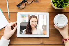 Close up of woman having video call on tablet pc stock images