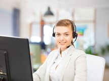 Helpline operator in headset working at office royalty free stock images