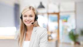 Helpline operator in headset working at office stock image