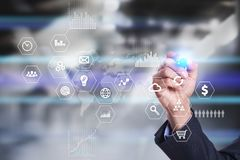 Business and technology concept. Graphs and icons on virtual screen background. Stock Photos