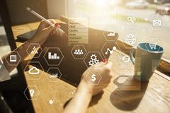 Business and technology concept. Graphs and icons on virtual screen background. Stock Image