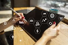 Business and technology concept. Graphs and icons on virtual screen background. Business and technology concept. Graphs and icons on virtual screen background Royalty Free Stock Photo