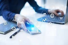 Business and technology concept. Graphs and icons on virtual screen background Stock Image