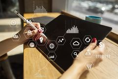 Business and technology concept. Graphs and icons on virtual screen background. Business and technology concept. Graphs and icons on virtual screen background Stock Photography