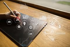 Business and technology concept. Graphs and icons on virtual screen background. Business and technology concept. Graphs and icons on virtual screen background Royalty Free Stock Images