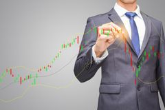 Finance and people concept in stock market index, Businessman or stock broker indicate signal sale or buy point at candle stick Stock Images