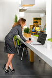 Business, technology and green office concept - young successful businesswoman with laptop computer at office. Woman using tablet Royalty Free Stock Photo