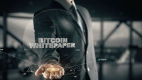 Bitcoin Whitepaper with hologram businessman concept stock video footage
