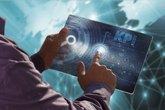 Business, Technology, Internet and network concept . Young busin. Ess man working on the tablet of the future , select the virtual screen : KPI Stock Image