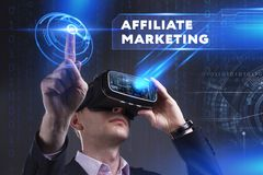 Business, Technology, Internet and network concept. Young busine. Ssman working in virtual reality glasses sees the inscription: Affiliate marketing Royalty Free Stock Image