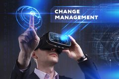 Business, Technology, Internet and network concept. Young busine. Ssman working in virtual reality glasses sees the inscription: Change management Stock Photography