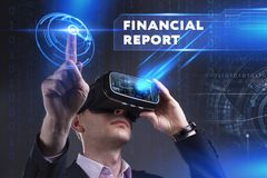 Business, Technology, Internet and network concept. Young busine. Ssman working in virtual reality glasses sees the inscription: Financial report Royalty Free Stock Photography