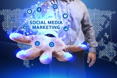 Business, Technology, Internet and network concept. Young busine. Ssman shows the word on the virtual display of the future: Social media marketing Stock Images