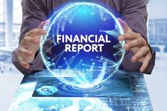 Business, Technology, Internet and network concept. Young busine. Ssman shows the word on the virtual display of the future: Financial report Royalty Free Stock Image