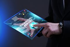 Business, Technology, Internet and network concept. Young busine. Ssman working on a virtual screen of the future and sees the inscription: Financial report Stock Images