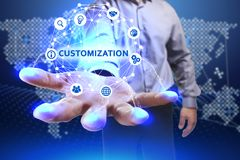 Business, Technology, Internet and network concept. Young busine. Ssman shows the word on the virtual display of the future: Customization Stock Photography