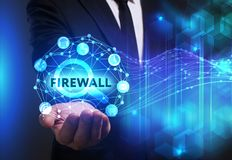 Business, Technology, Internet and network concept. Young busine. Ssman working on a virtual screen of the future and sees the inscription: Firewall Stock Image