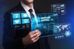 Business, Technology, Internet and network concept. Young busine. Ssman working on a virtual screen of the future and sees the inscription: Venture capital Stock Photo