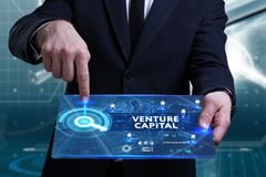 Business, Technology, Internet and network concept. Young busine. Ssman working on a virtual screen of the future and sees the inscription: Venture capital Stock Image