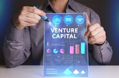 Business, Technology, Internet and network concept. Young busine. Ssman working on a virtual screen of the future and sees the inscription: Venture capital Royalty Free Stock Photo