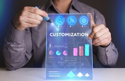 Business, Technology, Internet and network concept. Young busine. Ssman working on a virtual screen of the future and sees the inscription: Customization Royalty Free Stock Image