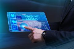 Business, Technology, Internet and network concept. Young busine. Ssman working on a virtual screen of the future and sees the inscription: Venture capital Stock Images