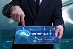 Business, Technology, Internet and network concept. Young busine. Ssman working on a virtual screen of the future and sees the inscription: Customization Stock Images