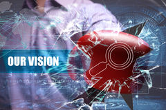 Business, Technology, Internet and network concept. Young businessman breaks the virtual future of the screen on which. The inscription: our vision stock photos