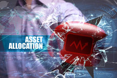 Business, Technology, Internet and network concept. Young busine. Ssman breaks the virtual future of the screen on which the inscription: asset allocation Stock Photos