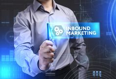Business, Technology, Internet and network concept. Young busine. Ssman showing a word in a virtual tablet of the future: Inbound marketing Stock Image