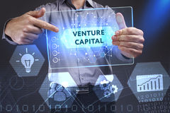 Business, Technology, Internet and network concept. Young busine. Ssman showing a word in a virtual tablet of the future: Venture capital Stock Image